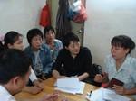 Guo Jianmei in a meeting