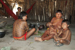 Yanomami family around their hearth