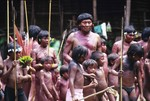 Davi Kopenawa surrounded by children in Demini, Brazil 1990